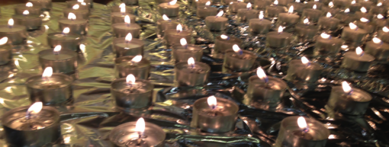 Last Friday I participated in the annual Homeless Memorial Service at the Church on the Hill in Boston. Prayers were said, songs sung, silences held, and names read. To be exact, we read 98 names—the names of people who died in Boston over the past year while experiencing homelessness. In addition to those 98 names, the audience added a dozen more in the silent space between readings. For each name, we lit a candle.